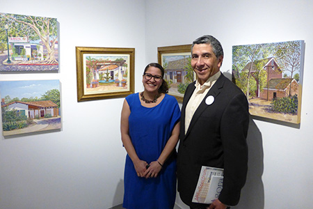 Miguel A. Chávez and Agora Gallery staff member at 'Heaven and Earth' exhibition in NYC